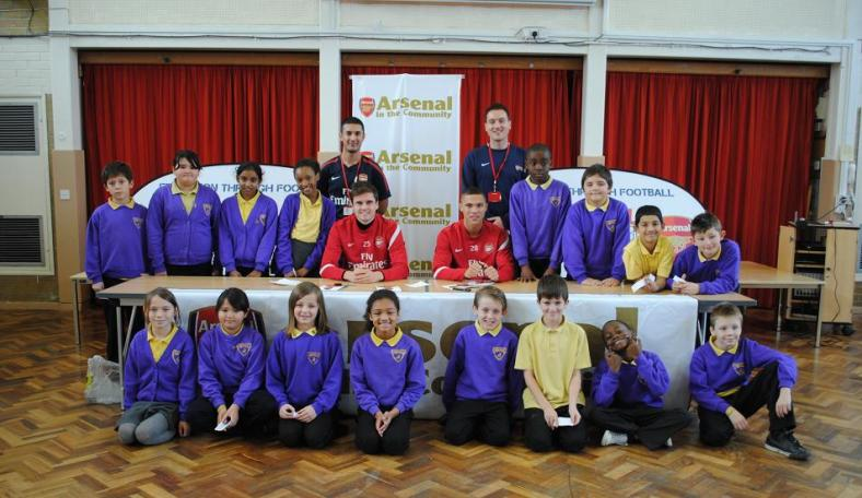 Arsenal players visit school