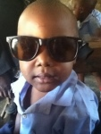 Ugandan child in sunglasses
