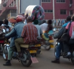 Transporting a mattress by motorbike